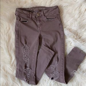 Deep mauve American eagle distressed skinny jeans